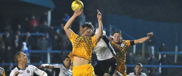 Morton midfielder Ross Forbes handles the ball in his own box and concedes a penalty