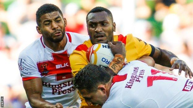 Kato Ottio (centre) played for Papua New Guinea in their quarter-final loss to England at the Rugby League World Cup in November