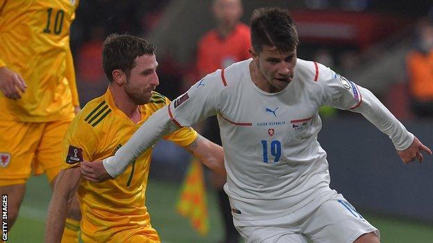 Czech Republic's midfielder Adam Hlozek and Wales' midfielder Joe Allen vie for the ball