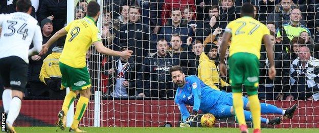 Scott Carson saves Nelson Oliveira's penalty