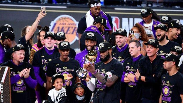 Los Angeles Lakers celebrate with NBA trophy
