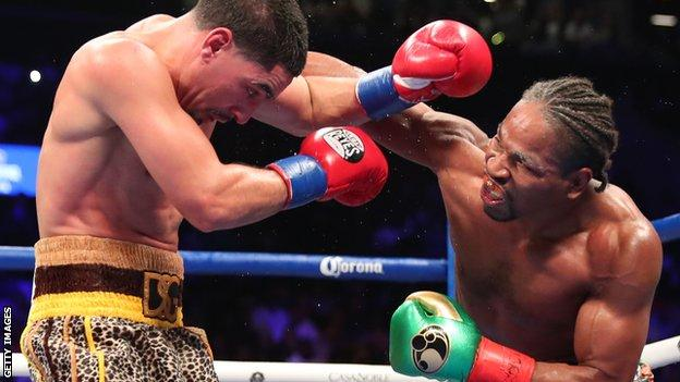 Shawn Porter throws a right-handed punch at Danny Garcia