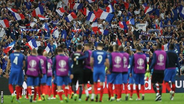 The France players at the end of the game, with a backdrop of French fans