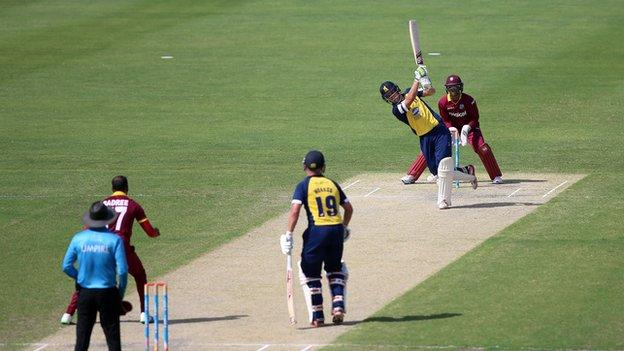 Warwickshire's Sam Hain goes aerial against the West Indies in the Persian Gulf