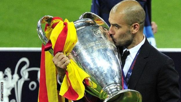 Pep Guardiola with the Champions League trophy after Barcelona beat Manchester United in 2011