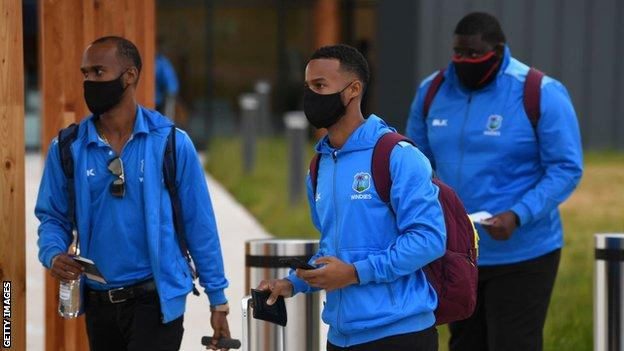West Indies players Kraigg Brathwaite (left), Shai Hope (centre) and Rakheem Cornwall (right) arrive at Manchester Aiport wearing face masks before their Test tour of England