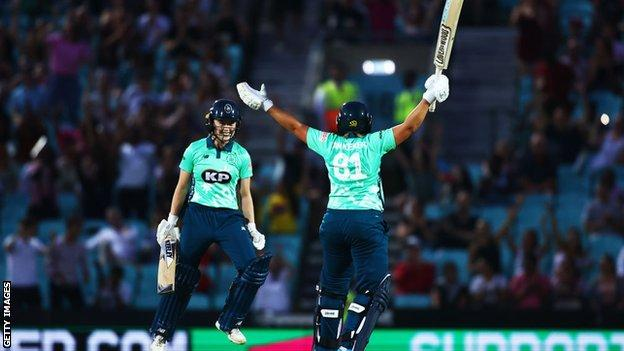 Dane van Niekerk and Mady Villiers of Oval Invincibles celebrate the winning runs during The Hundred match between Oval Invincibles and Manchester Originals at The Kia Oval