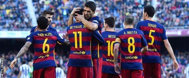 Barcelona's players celebrate a goal against Real Sociedad