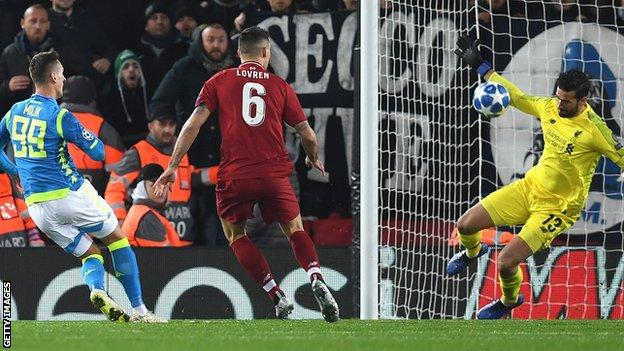 Alisson saves from Milik