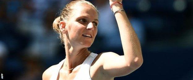 Karolina Pliskova celebrates after victory in under an hour