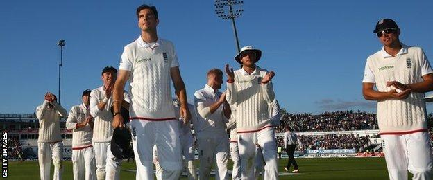England leave the field after day two