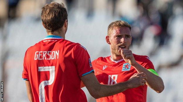 Lars Krogh Gerson and Laurent Jans are about to embrace after Luxembourg's Nations League win over Cyprus last October