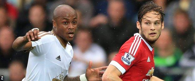 Andre Ayew (left) with Daley Blind