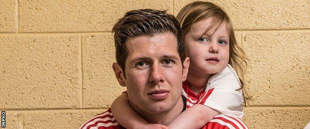 Tyrone senior football captain Sean Cavanagh with his daughter Eva