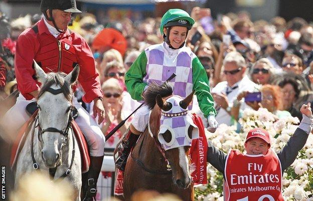 Michelle Payne and brother Stevie (right) celebrate the Melbourne Cup victory