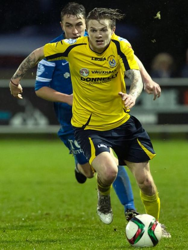 Paul McElroy of Dungannon Swifts goes on the offensive with Ballinamallard United defender Emmett Friars in pursuit