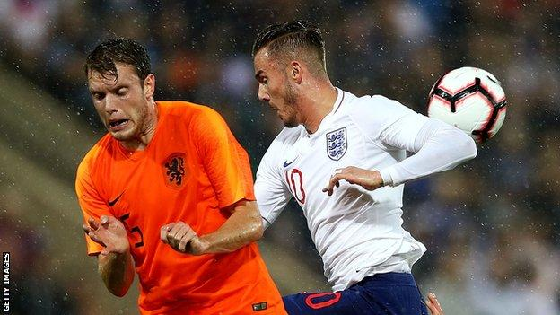 Thomas Ouwejan of the Netherlands compete for the ball with James Maddison of England