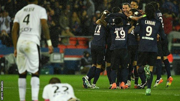 Paris St-Germain's players celebrate scoring against Rennes