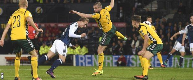 Leigh Griffiths send a header straight at the Lithuania keeper