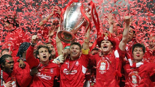 Liverpool players celebrate with the trophy after winning the 2004/05 Champions League final