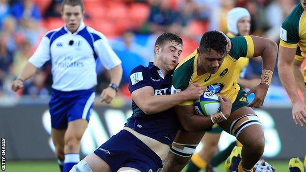 Callum Hunter-Hill of Scotland tackles Robert Leota of Australia