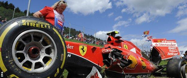 Kimi Raikkonen's Ferrari was involved in a dramatic crash with Fernando Alonso on the first lap
