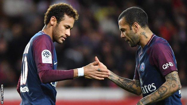 Neymar and Dani Alves celebrate a Paris St-Germain goal