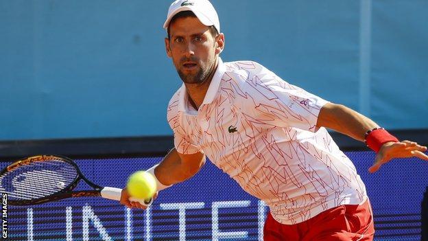 Novak Djokovic hits a forehand