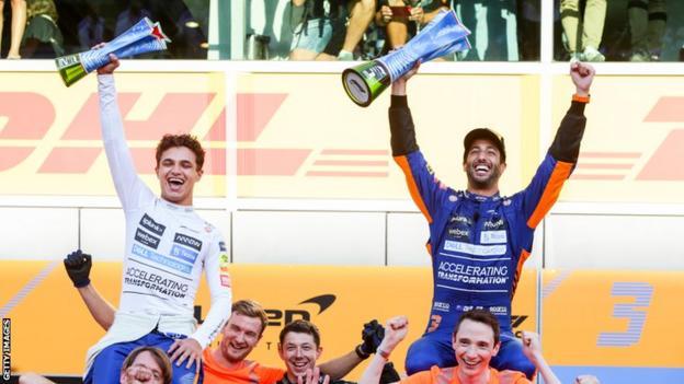Lando Norris and Daniel Ricciardo celebrate their podium finishes at Monza