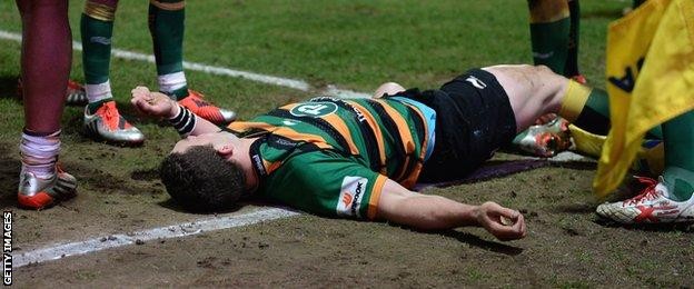 George North lies unconscious after being hit in the head while playing for Northampton last season