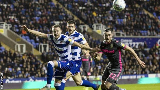 Chris Gunter in action for Reading v Leeds, clearing the ball