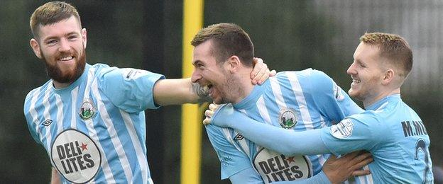 Congratulations for Stephen Murray after he scores in the 3-0 win over Coleraine