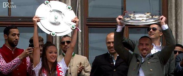 Lisa Evans and Franck Ribery celebrate Bayern Munich's triumphs