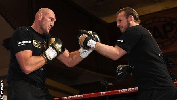 Tyson Fury (left) spars with his trainer Ben Davison