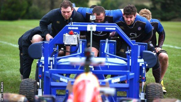 Daniel Ricciardo pits an F1 car against the Bath rugby scrum