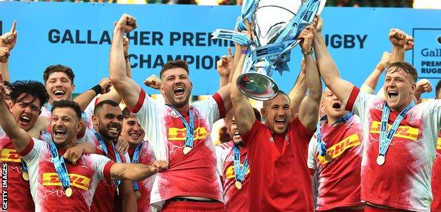Harlequins celebrate with the Premiership trophy