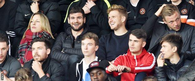 Ex-Dundee United players Nadir Ciftci (centre left) and Stuart Armstrong watched from the stand