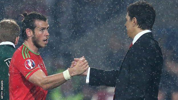 Gareth Bale is greeted by Wales manager Chris Coleman