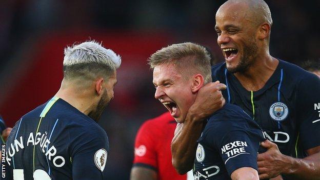 Oleksandr Zinchenko, Sergio Aguero and Vincent Kompany celebrate Manchester City's third goal against Southampton