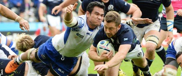 Greig Laidlaw dives to score a Scotland try