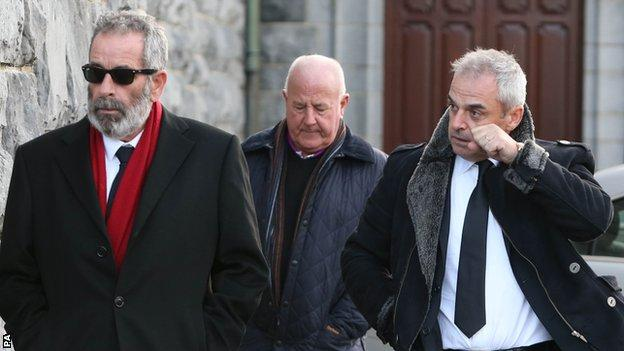 Sam Torrance (left) and Paul McGinley (right) arrives for the funeral of Christy O'Connor Jnr