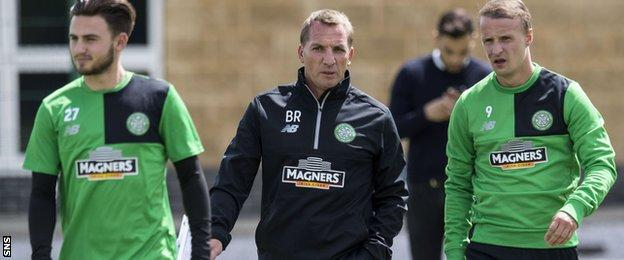 Brendan Rodgers (centre) makes a point to Celtic striker Leigh Griffiths (right)