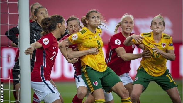 Josie Green having shirt pulled in Norway match
