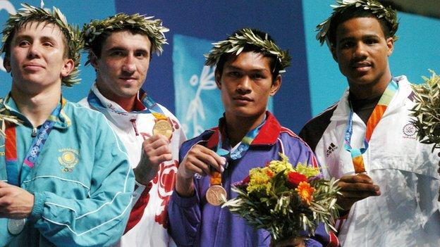 Golovkin (left) lost to Gaydarbekov (second left) in the 2004 Olympic final