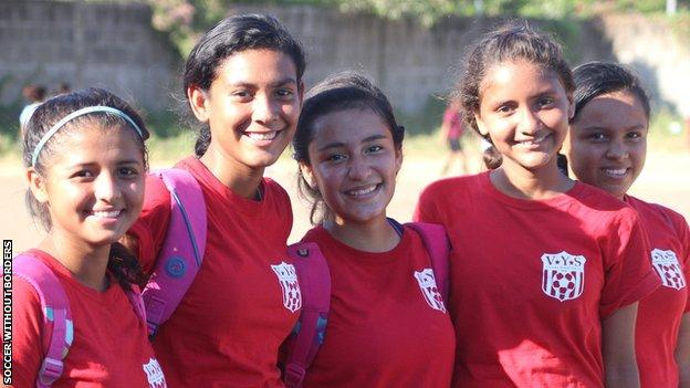 Hasly (centre) poses for a picture with some of her team-mates