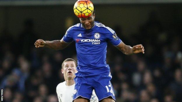 John Mikel Obi heads the ball