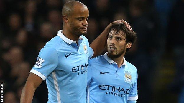 Vincent Kompany is consoled by team-mate David Silva