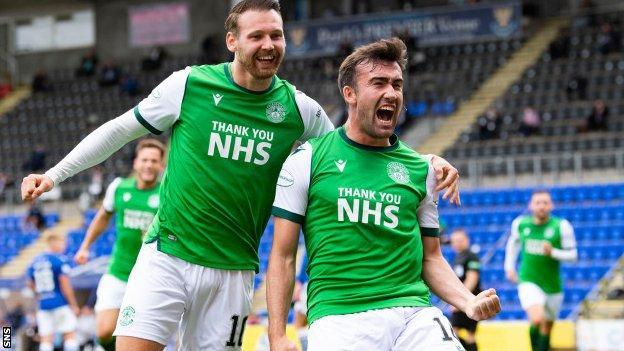 Hibernian midfielder Stevie Mallan (right) celebrates
