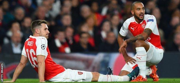England and Arsenal forward Theo Walcott (R) has also suffered with injury problems