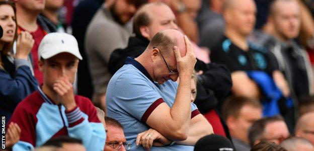 West Ham supporters show their frustration